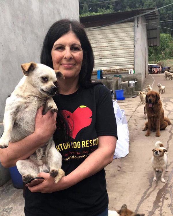 Cindi holding a Chinese rescue dog
