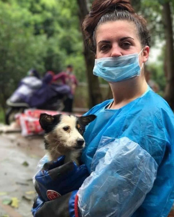 Zoe holding a Chinese rescue dog